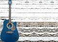 Acoustic guitar in textured wooden wall old blue old grunge with copyspace Stock Image