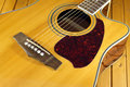 Acoustic guitar top with six strings closeup classic natural color fragment Royalty Free Stock Photos