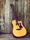 Acoustic guitar on wood. Stock Photography