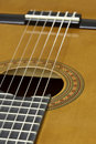 Acoustic six string guitar showing the rosette and sound hole Stock Photography