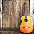 Acoustic wooden guitar leaning on a wooden fence advertisement with room for text or copy space Stock Photos