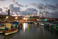 Acre fishing harbor israel july local boats yachts with and nearby monuments at sunset in the in the old city of Royalty Free Stock Photography
