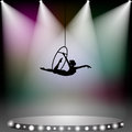 Acrobat woman on circus aerial stage with spotlights Royalty Free Stock Photography