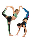Acrobatic composition of two flexible girls isolated on white Stock Images