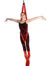 Acrobatic girl exercising on red fabric rope gymnastic isolated white background Stock Image