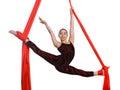 Acrobatic gymnastic girl exercising on fabric rope red isolated white background Stock Image