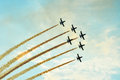 Acrobatic planes doing acrobatics at an Airshow flying at sunset Royalty Free Stock Photo