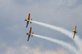 Acrobatic yak planes at bias bucharest international air show in action in the sky Royalty Free Stock Photo