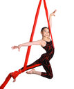Acrobatic young girl exercising on red fabric rope gymnastic isolated white background Royalty Free Stock Photography