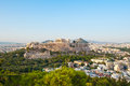 Acropolis of Athens and Lycabettus Hill on the background as seen from Filopappos Hill. Royalty Free Stock Photo