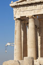 Acropolis of Athens. Parthenon columns and crane. Greece Royalty Free Stock Photo
