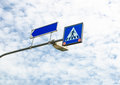 Across road sign with blue sky Royalty Free Stock Photo
