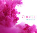 Acrylic colors in water, abstract background. Royalty Free Stock Photo