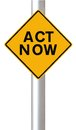 Act now a road sign indicating Royalty Free Stock Images