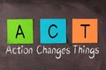 Action changes things and act acronym chalk text Stock Image