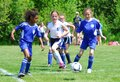 The action is fast in this girls soccer game Royalty Free Stock Photo
