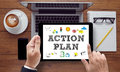 Action plan businessman work on white broad top view on the tablet pc screen held by businessman hands online top view Royalty Free Stock Photography