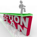 Action Plan - Man on Arrow Over Words Royalty Free Stock Photography