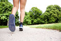 Action portrait of lady runner shoes on path Royalty Free Stock Photo