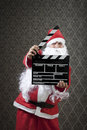 And action santa invades hollywood with confidence Royalty Free Stock Images
