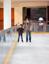 Action shot of beautiful women teaching her daughter how to ice skate Stock Image