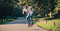 Action shot of a skateboarder skating, doing tricks and jumping Royalty Free Stock Photo