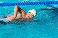 Action shot of teen freestyle swimmer. Royalty Free Stock Photo