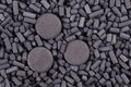 Activated carbon granules and tablets background Royalty Free Stock Image