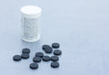 Activated Charcoal Tablets For Cleansing The Body On A Gray Background Closeup Royalty Free Stock Photo