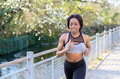 Active athletic young woman out jogging Royalty Free Stock Photo