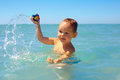 Active baby playing water game in the sea boy Royalty Free Stock Images