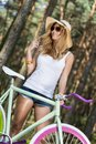 Active beautiful girl with bike picture of sporty Stock Image