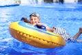 Active boy enjoying water slide in aquapark