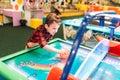 Active boy plays air hockey, entertainment center Royalty Free Stock Photo