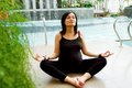 Active ethnic pregnant woman exercise yoga Stock Photo