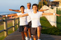 Active family exercising modern at the beach Royalty Free Stock Photography