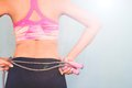 Active female in fitness clothing with jumping rope, Healthy and workout concept Royalty Free Stock Photo