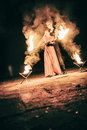 Active girls and boys carries out tricks for fire show at night Royalty Free Stock Photo