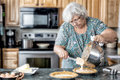 Active grandmother baking Stock Photo