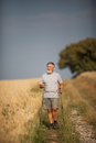 Active handsome senior man nordic walking outdoors Royalty Free Stock Photo