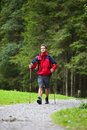Active handsome young man nordic walking Royalty Free Stock Photography