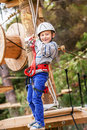 Active happy boy in the rope park attraction Royalty Free Stock Image