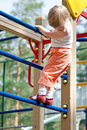 Active little child climbing on a high ladder Royalty Free Stock Photos