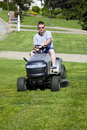 Active Man Mowing lawn Stock Images