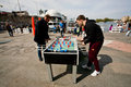 Active men have fun during foosball game kiev ukraine on the street festival on the banks of dnieper river kiev is largest city in Stock Image