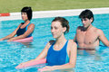 Active people doing aqua gym in a pool Stock Photos
