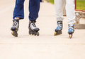 Active people friends rollerskating outdoor woman and men riding enjoying sport Royalty Free Stock Photos
