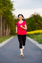 Active people middle age woman jumping running outdoor Royalty Free Stock Images