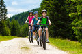 Active people mother kids biking Royalty Free Stock Image