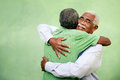 Active retired old men leisure two senior black brothers hugging outdoors Royalty Free Stock Photo